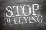 Stop Bullying written on blackboard poster