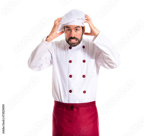 frustrated chef over white background - 73829694
