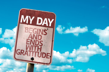 My Day Begins and Ends With Gratitude sign with sky background