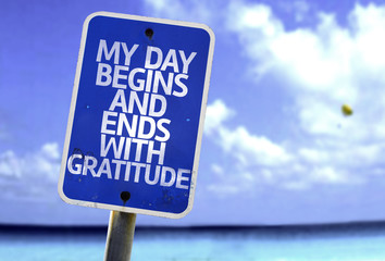 My Day Begins and Ends With Gratitude sign with a beach