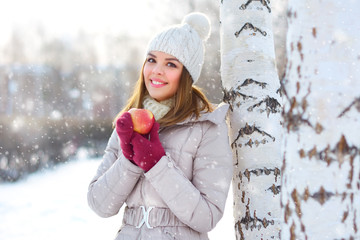 smiling girl with a red apple