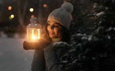 Cute girl with a lantern