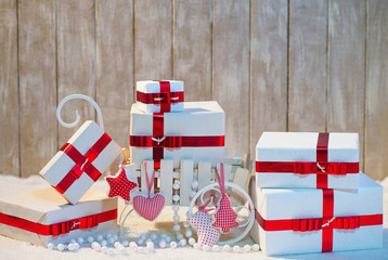 Wrapped Christmas gift boxes with red ribbon bows