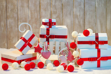Decorated Christmas gift boxes with red ribbon bows