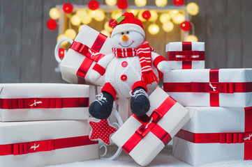 Christmas gift boxes with red ribbons and snowman decoration