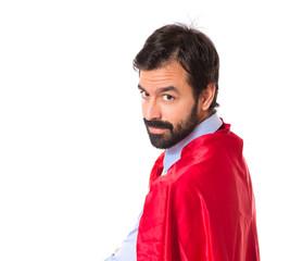 Businessman dressed like superhero proud of himself