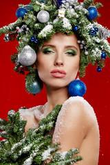 Beautiful woman portrait  in creative christmas  image.