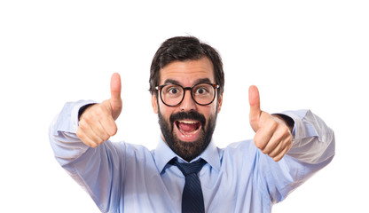 Businesssman with thumb up over white background