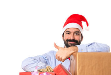 Christmas man with gifts over white