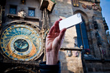 Taking picture with mobile at Prague clock