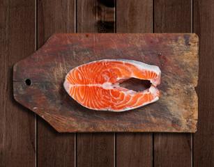 raw salmon on wooden cutting board