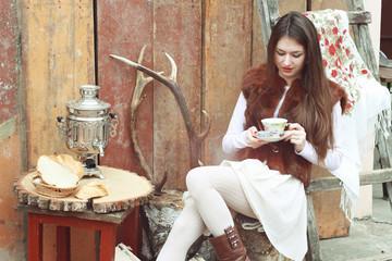 girl drinking tea outdoors