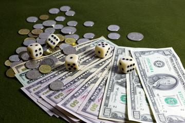 White Dices, Coins and American Dollar Bills on Green Table
