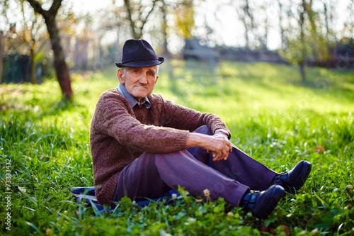 Leinwanddruck Bild Old farmer resting