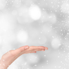 Woman hand on Christmas background