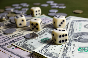 White Dices,Coins and American Dollar Banknotes on Green Table
