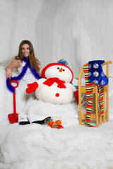 The beautiful young girl posing in christmas decorations