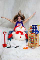 The beautiful young girl posing in christmas interior decoration