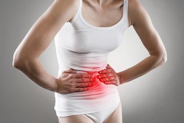 Female having stomachache. Abdomen bloating concept.