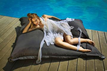 Sexy girl sunbathing on the beach pool tropical