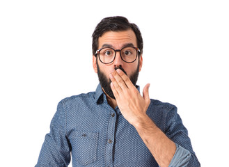 Young hipster man doing surprise gesture