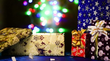 open holiday box at colorful lights background
