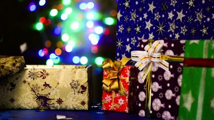 gift boxes at colorful holiday background