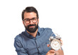 Young hipster man holding a clock