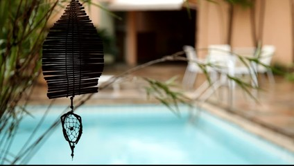 dream catcher spinning with a pool on the background