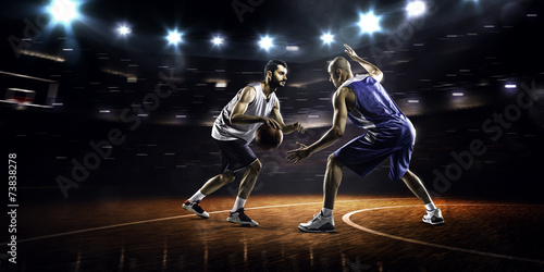Poster Two basketball players in action