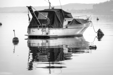 Old recreational boat moorage, Lake Maggiore, winter. BW image