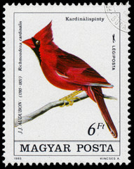 Stamp printed in Hungary shows common cardinal