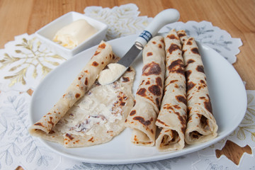Lefse rolled on a plate