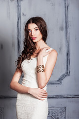Beautiful young girl in a white dress
