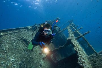 Divers exploring a wreck