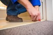 canvas print picture - Handyman laying down a carpet