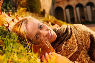 relaxed fashion model in autumn in a country house