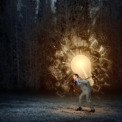 Man carrying bulb