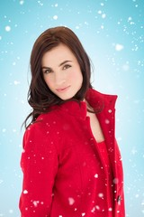 Composite image of portrait of a brunette in red coat posing