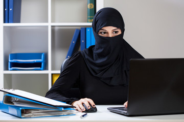 Muslim businesswoman in office