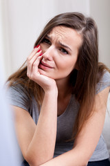 Woman crying at psychotherapist's room
