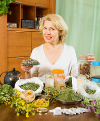 mature woman doing herbal tea
