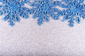 White snowflakes on a background of silver sequins