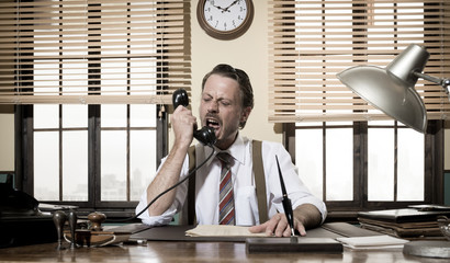 Angry vintage businessman shouting on the phone