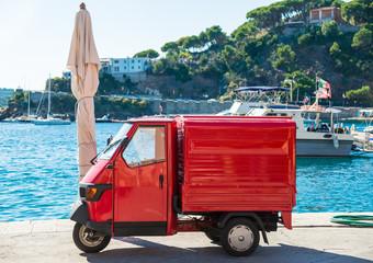 Italian symbolic red car three wheels Ape car, Elba, Italy