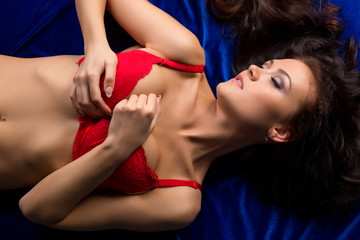 Top view of passionate underwear model lying