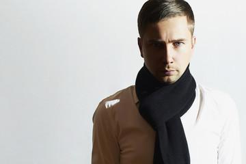 Fashionable Handsome Young Man in scarf.Stylish Europian Boy