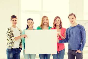 students at school holding white blank board