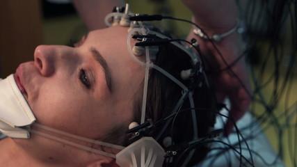 Doctor preparing woman for brain scan in hospital