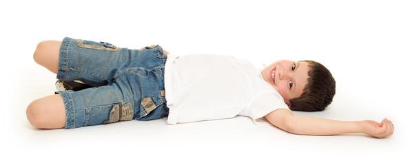 boy lie on white